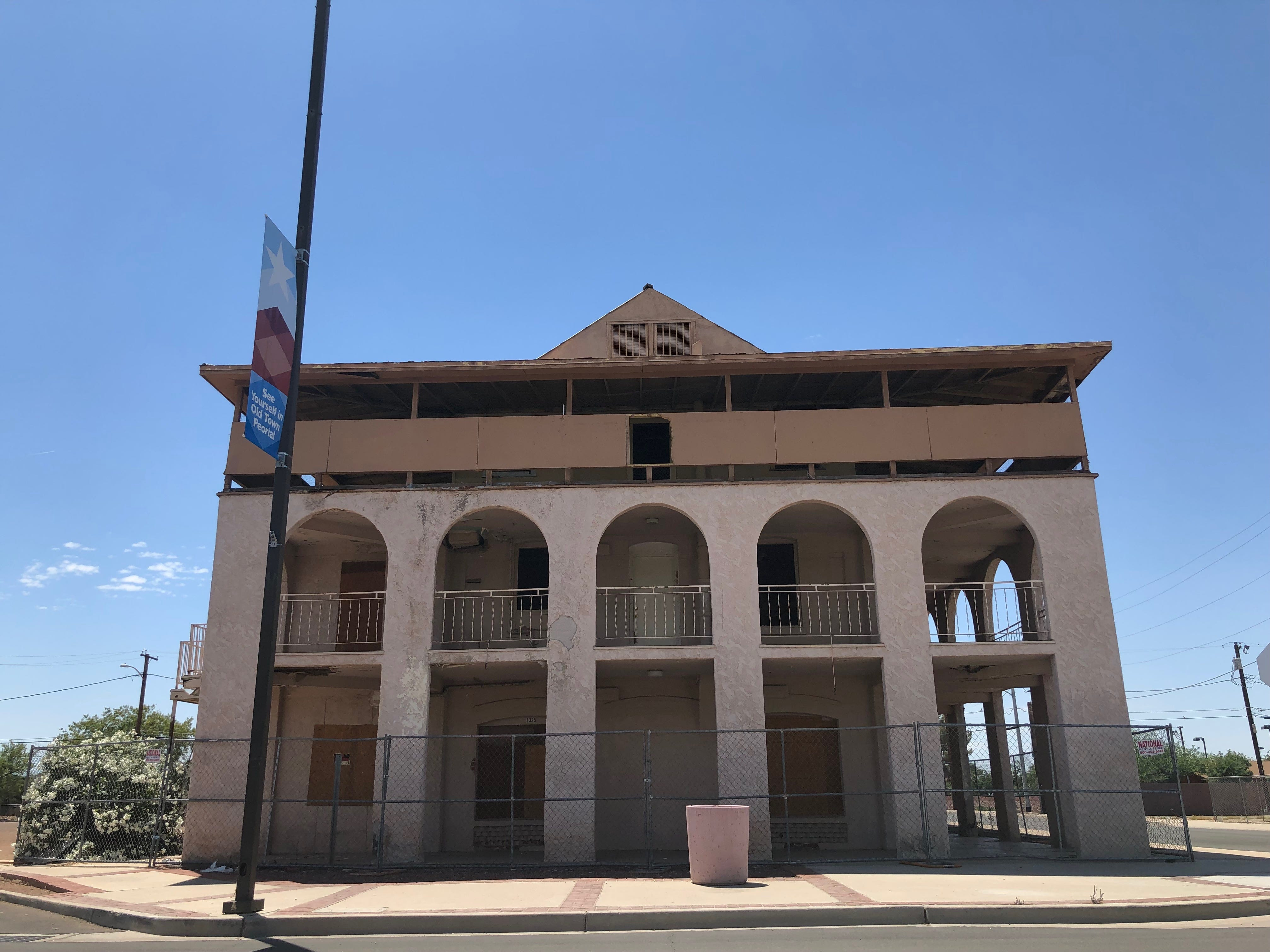 Old Town Peoria's Edwards Hotel was supposed to transform into a vacation destination by the end of 2018. Now, it's still vacant and fenced-off.