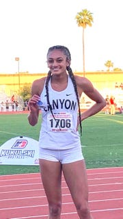 Phoenix North Canyon sprinter Dominique Mustin shows her medal after winning the 100-meter hurdles at the 2019 girls track and field state championships.