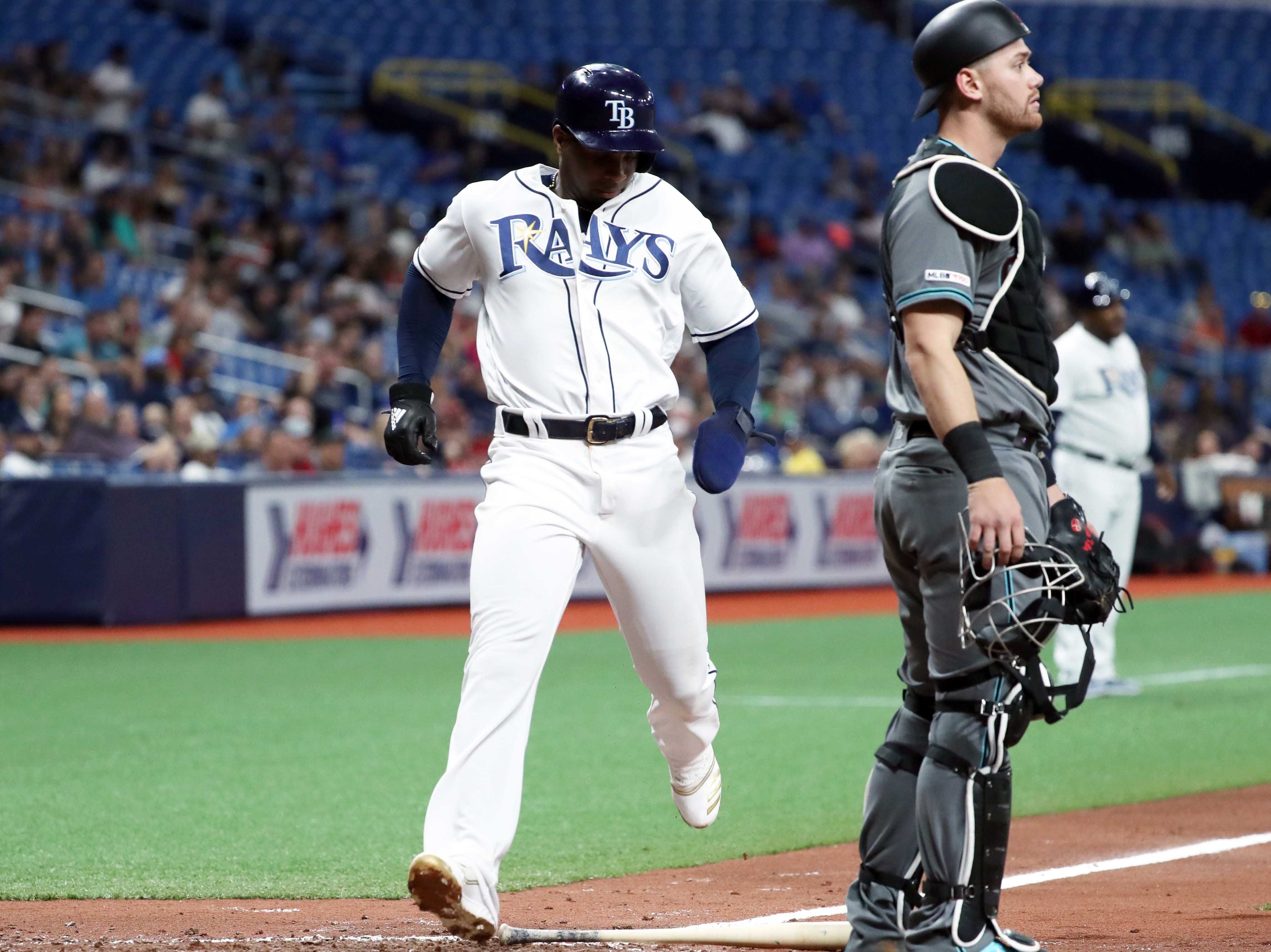 May 7, 2019; St. Petersburg, FL, USA; Tampa Bay Rays third baseman Yandy Diaz (2) scores a run as Arizona Diamondbacks catcher Carson Kelly (18) looks on during the fourth inning at Tropicana Field. Mandatory Credit: Kim Klement-USA TODAY Sports