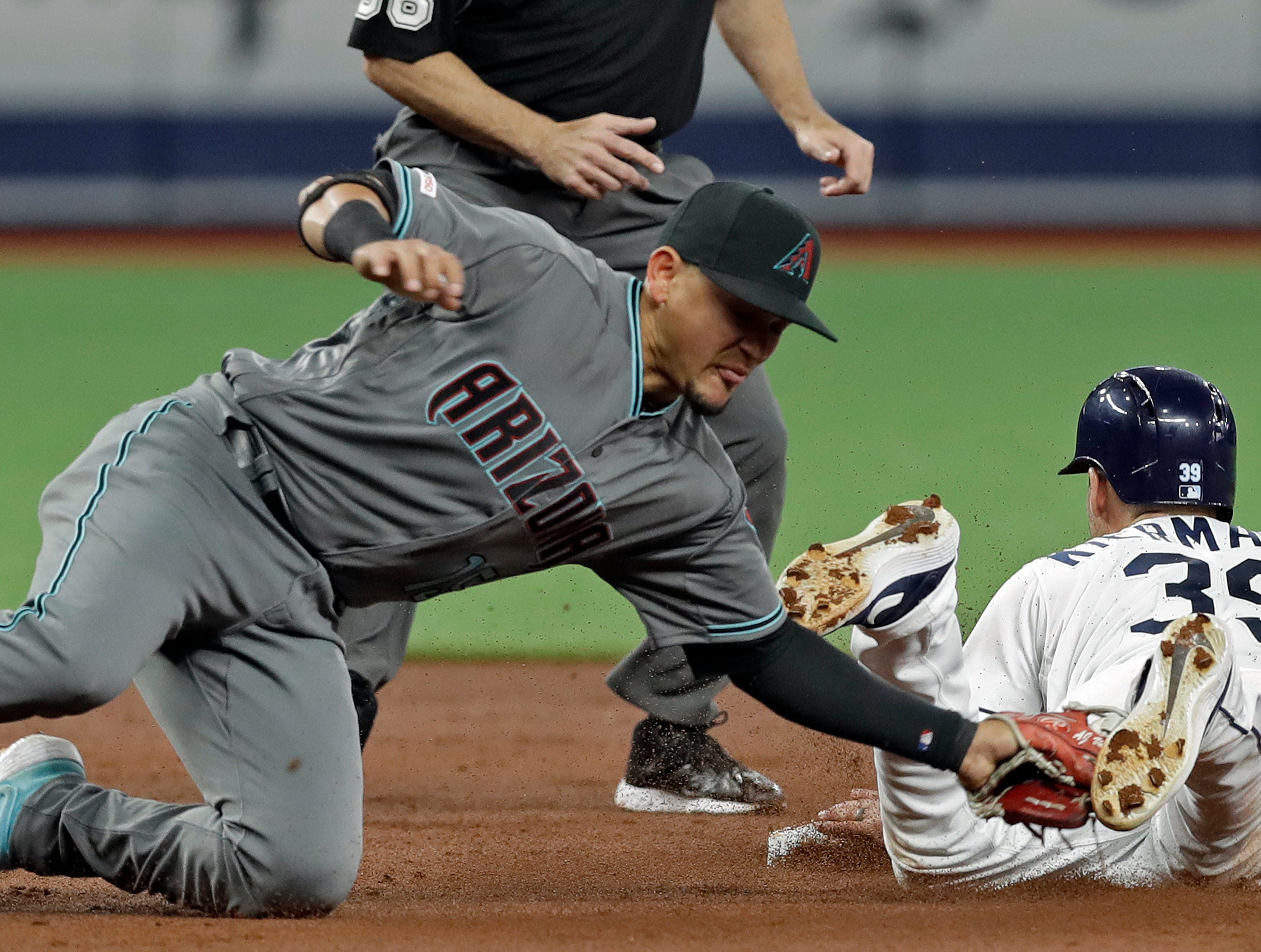 Arizona Diamondbacks' Eduardo Escobar is late with the tag as Tampa Bay Rays' Kevin Kiermaier (39) steals second base during the second inning of a baseball game Tuesday, May 7, 2019, in St. Petersburg, Fla. (AP Photo/Chris O'Meara)