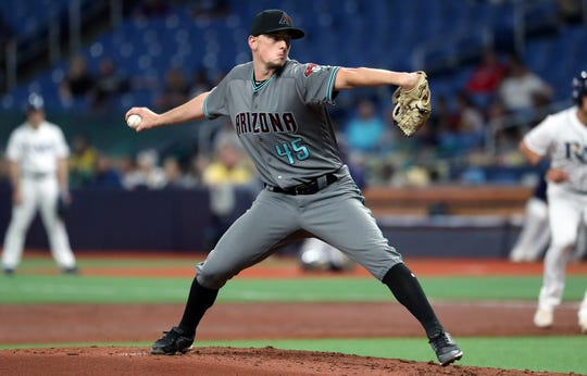 May 7, 2019; St. Petersburg, FL, USA; Arizona Diamondbacks starting pitcher Taylor Clarke (45) throws a pitch during the second inning against the Tampa Bay Rays  at Tropicana Field. Mandatory Credit: Kim Klement-USA TODAY Sports
