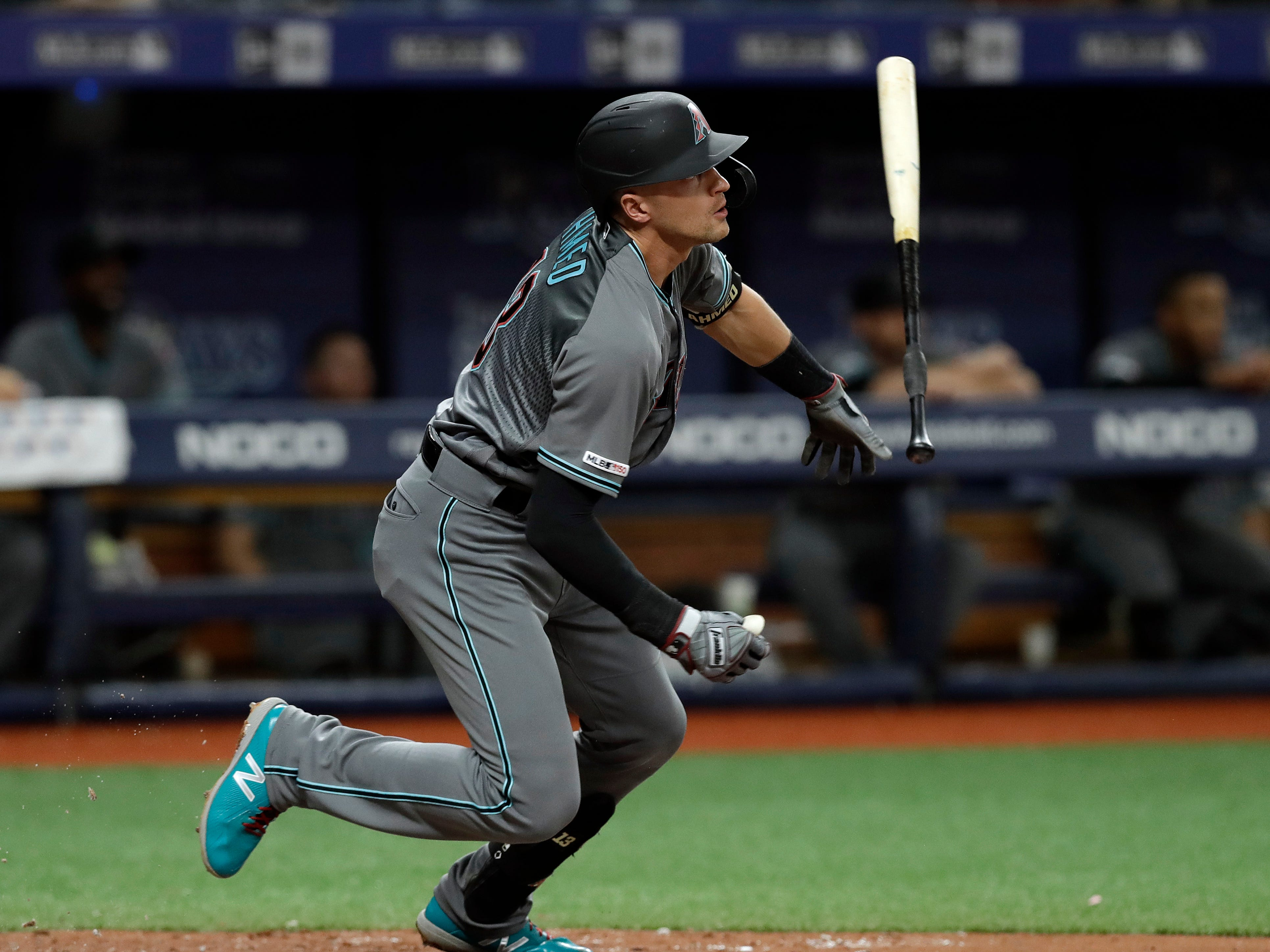 Arizona Diamondbacks' Nick Ahmed flips his bat after his RBI-double off Tampa Bay Rays relief pitcher Jalen Beeks during the fourth inning of a baseball game, Tuesday, May 7, 2019, in St. Petersburg, Fla. Arizona's Adam Jones scored. (AP Photo/Chris O'Meara)