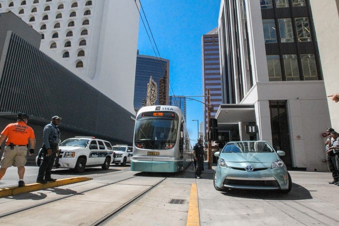A car vs. train collision near Washington Street and Central Avenue in Phoenix causes delays for the light rail on May 8, 2019.