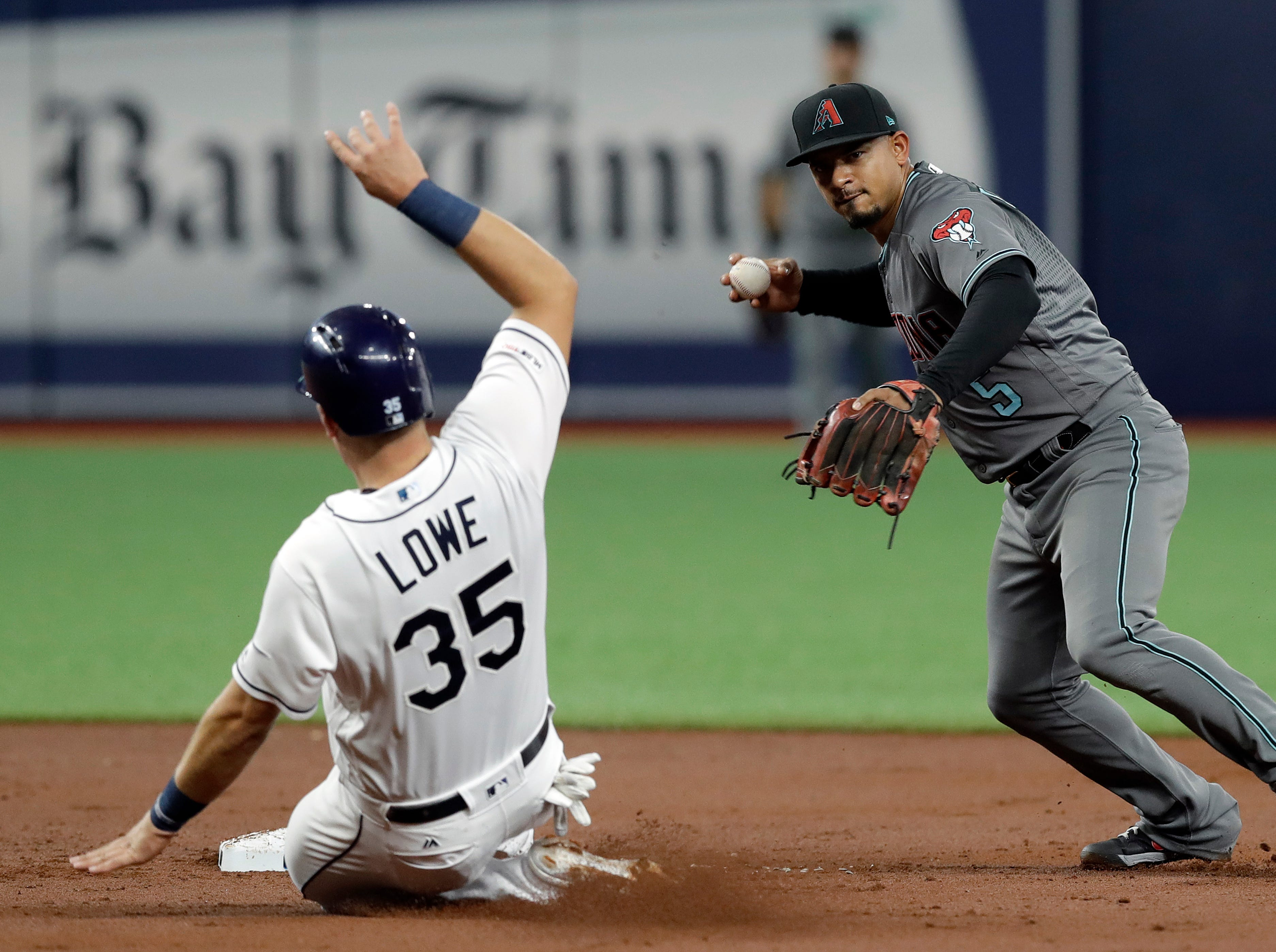 Arizona Diamondbacks' Eduardo Escobar (5) looks to first after forcing out Tampa Bay Rays' Nathaniel Lowe on a ball hit by Kevin Kiermaier, who was safe at first during the second inning of a baseball game Tuesday, May 7, 2019, in St. Petersburg, Fla. (AP Photo/Chris O'Meara)