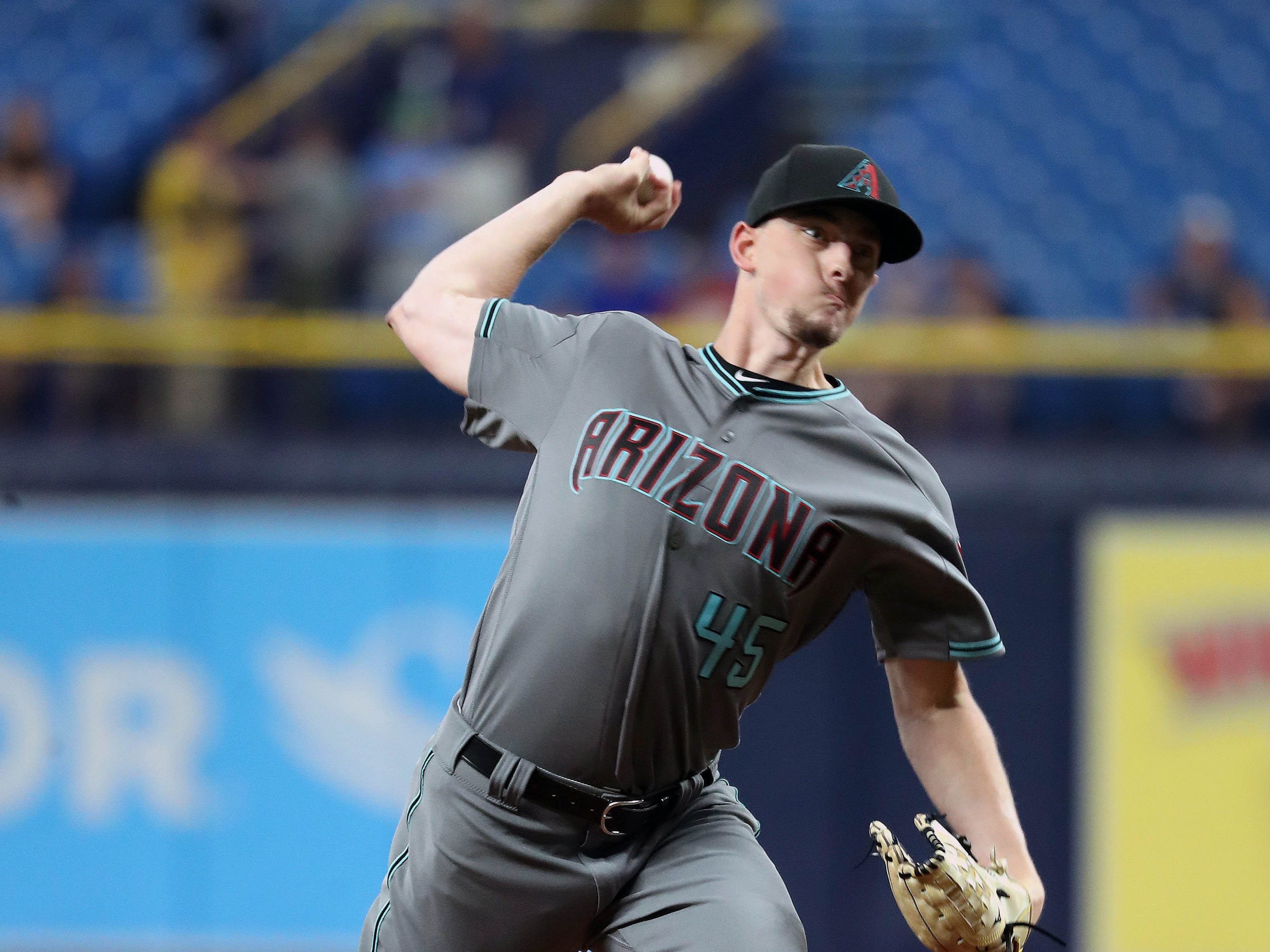 May 7, 2019; St. Petersburg, FL, USA; Arizona Diamondbacks starting pitcher Taylor Clarke (45) throws a pitch during the first inning against the Tampa Bay Rays at Tropicana Field. Mandatory Credit: Kim Klement-USA TODAY Sports