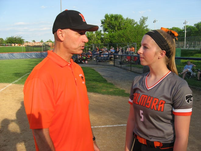 Coach Tod Whitman discusses strategy with senior catcher Sara Boyer prior to a game this past season. Whitman stepped down last week after a successful four-season tenure at the helm.