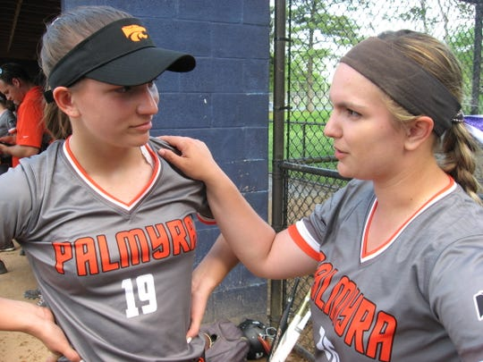 Senior pitcher Abbey Krahling, right, gives advice to her freshman sister Samantha prior to Tuesday's win over Hershey that clinched the Mid-Penn Keystone title.