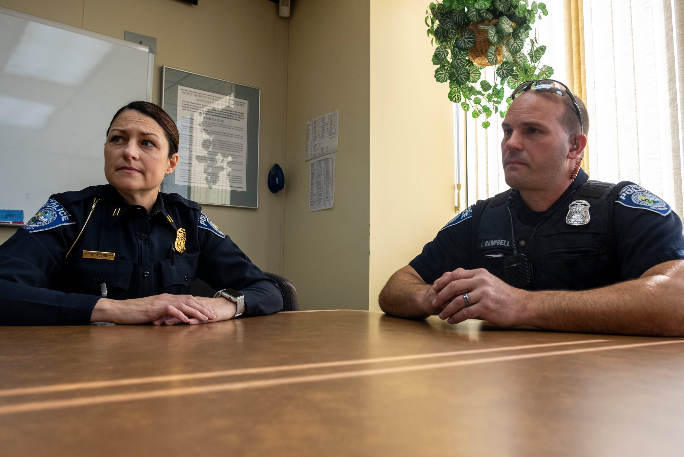 Port Huron Police Capt. Marcy Kuehn, left, and Officer Jim Campbell talk in one of the department's conference rooms Wednesday, May 8, 2019.