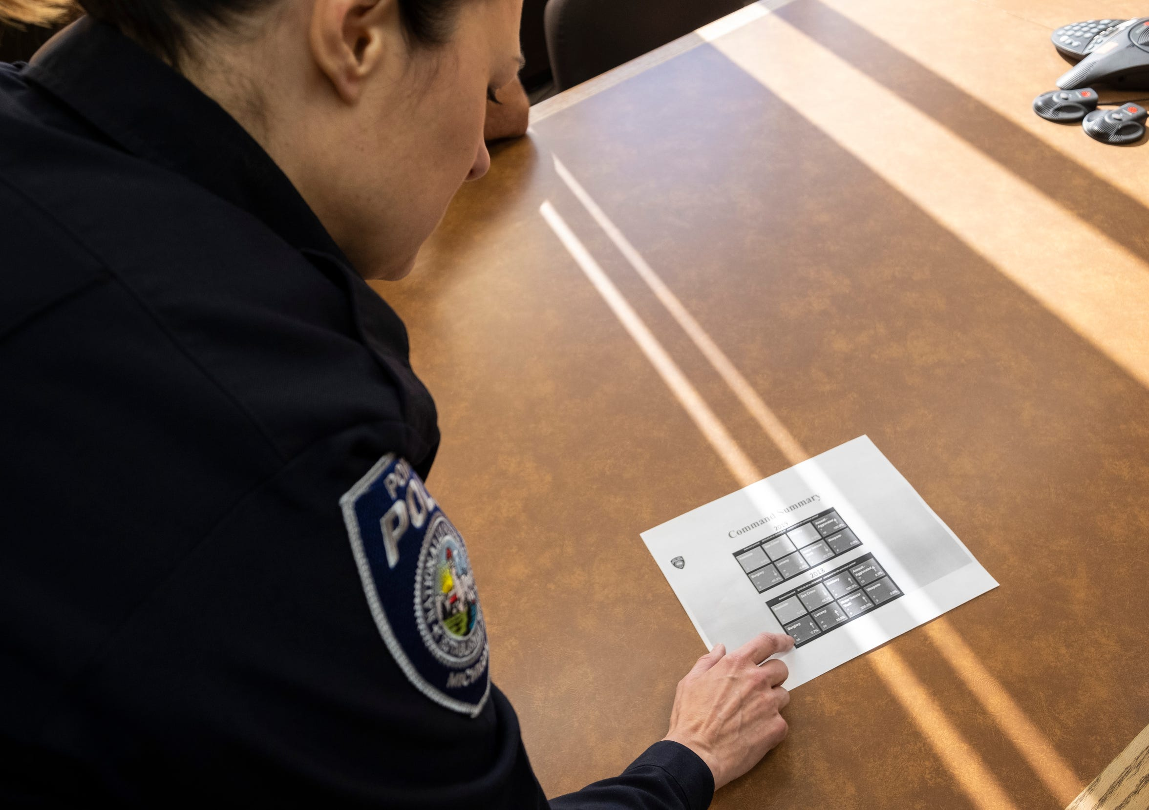 Port Huron Police Capt. Marcy Kuehn shows a report that displays changes in local crime trends used by the department Wednesday, May 8, 2019 in one of the department's conference rooms.