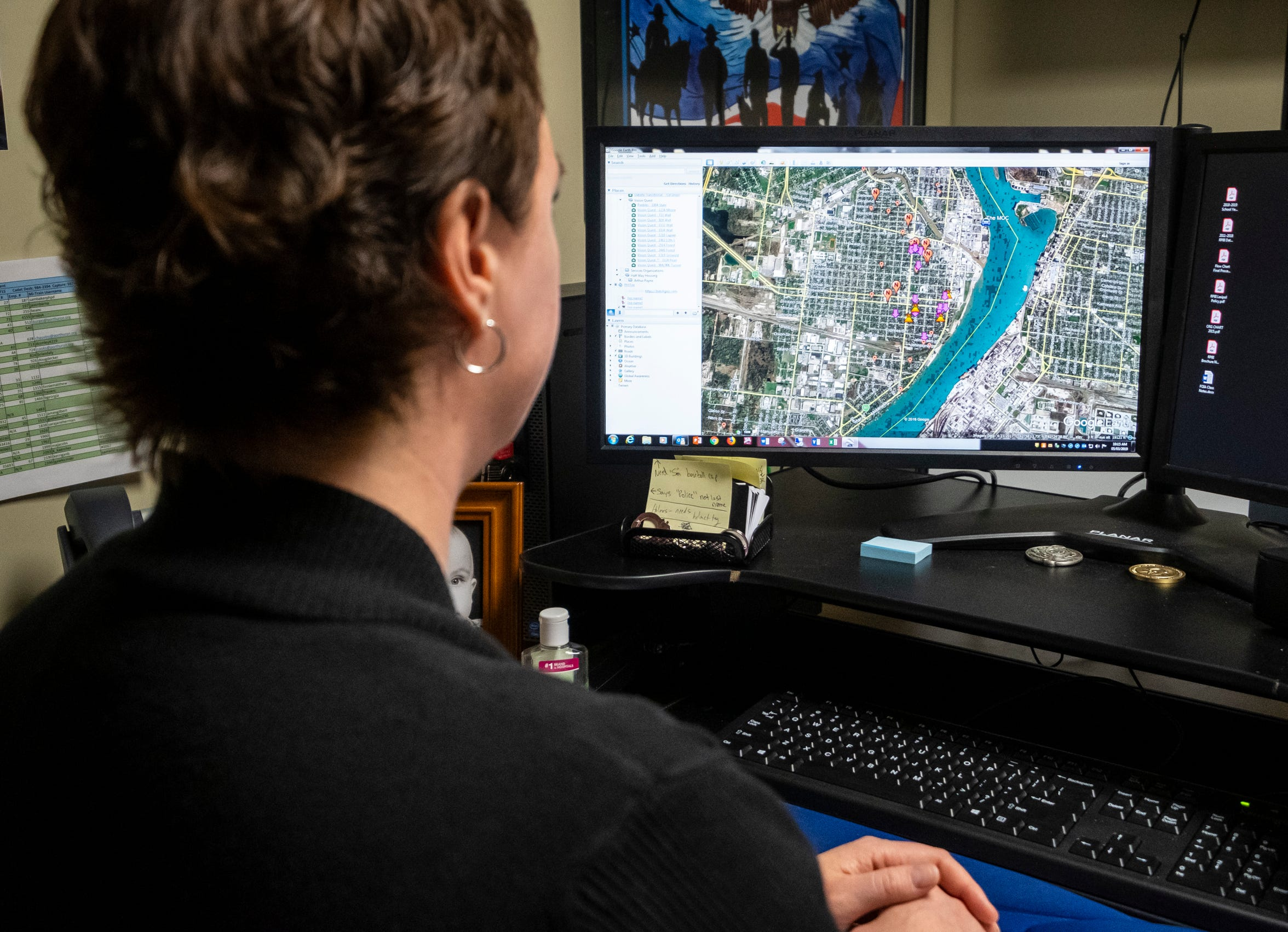 Port Huron Police Department Crime Analyst Melissa Jacobs uses software that shows the locations of different crimes Friday, May 3, 2019 in her office in the Municipal Office Center.
