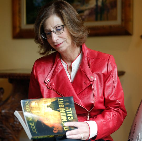 "Jode Millman with her novel, ""The Midnight Call,"" at her home in the City of Poughkeepsie on May 2, 2019. Millman, a semi-retired lawyer, penned a novel about her junior high school social studies teacher, convicted murderer Albert Fentress."