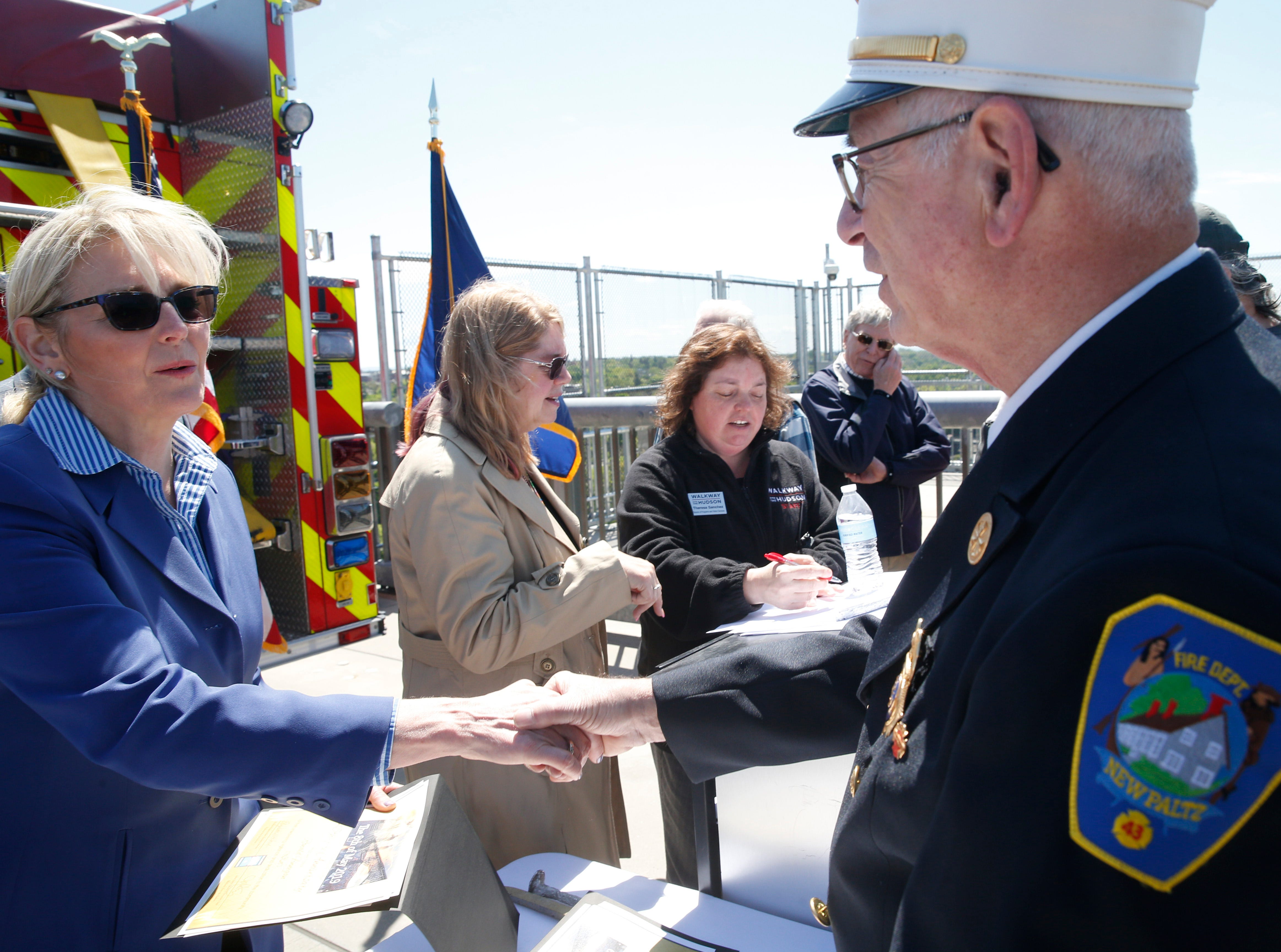 Walkway Over the Hudson executive director Elizabeth Waldstein-Hart gives a certificate of appreciation to former fire chief of New Paltz Fire Department George Wirthmann during Wednesday's commemoration of 45th anniversary of the fire that engulfed the railroad bridge on May 8, 2019.