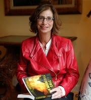 "Jode Millman with her novel, ""The Midnight Call"" at her home in the City of Poughkeepsie on May 2, 2019. Millman, a retired lawyer penned a novel about her middle school social studies teacher, convicted murderer Albert Fentress."