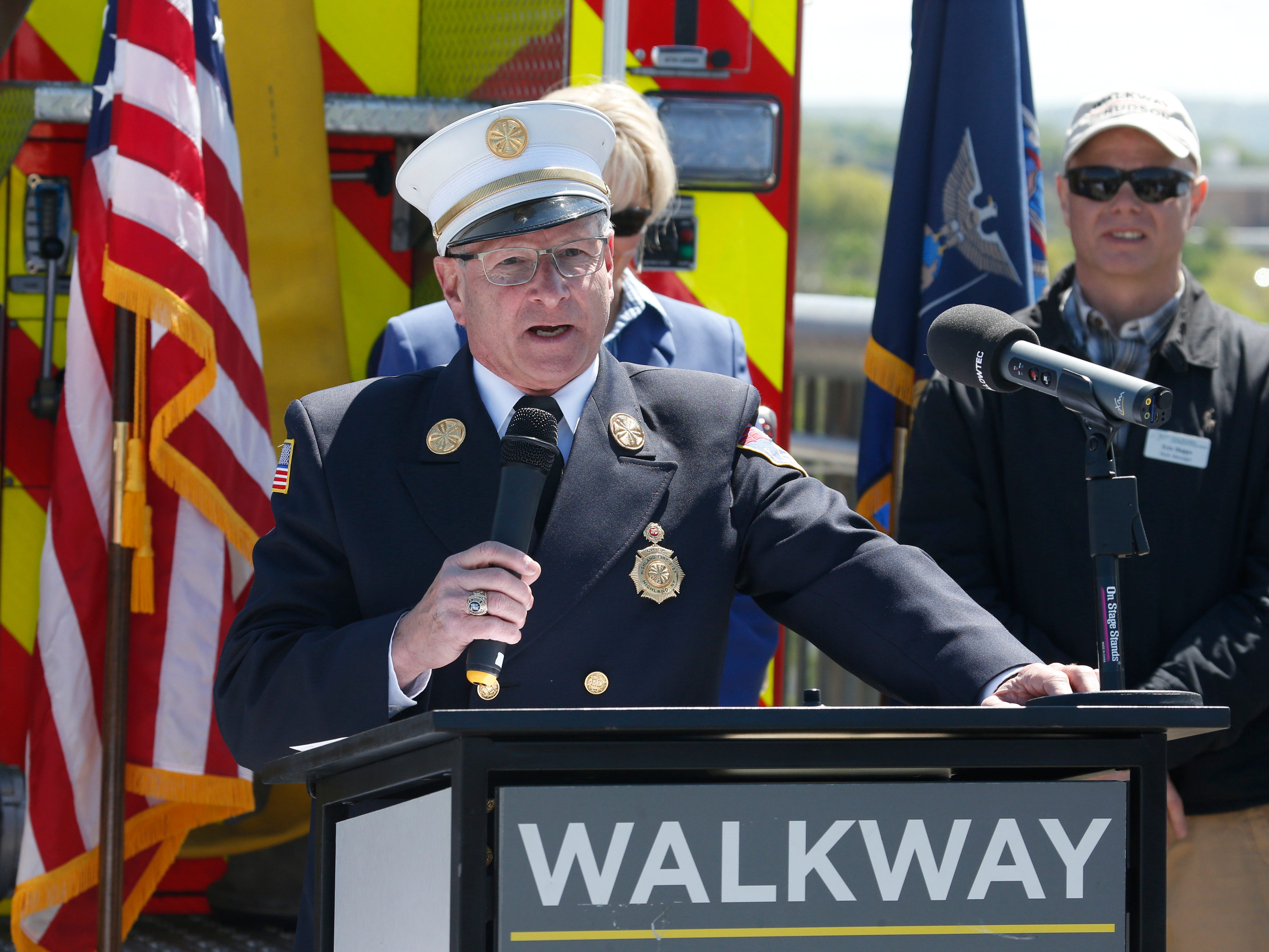 Highland fire chief Peter Miller speaks during Wednesday's commemoration of 45th anniversary of the fire that engulfed the railroad bridge on May 8, 2019. Miller was one of the firefighters who responded to the fire in 1974.