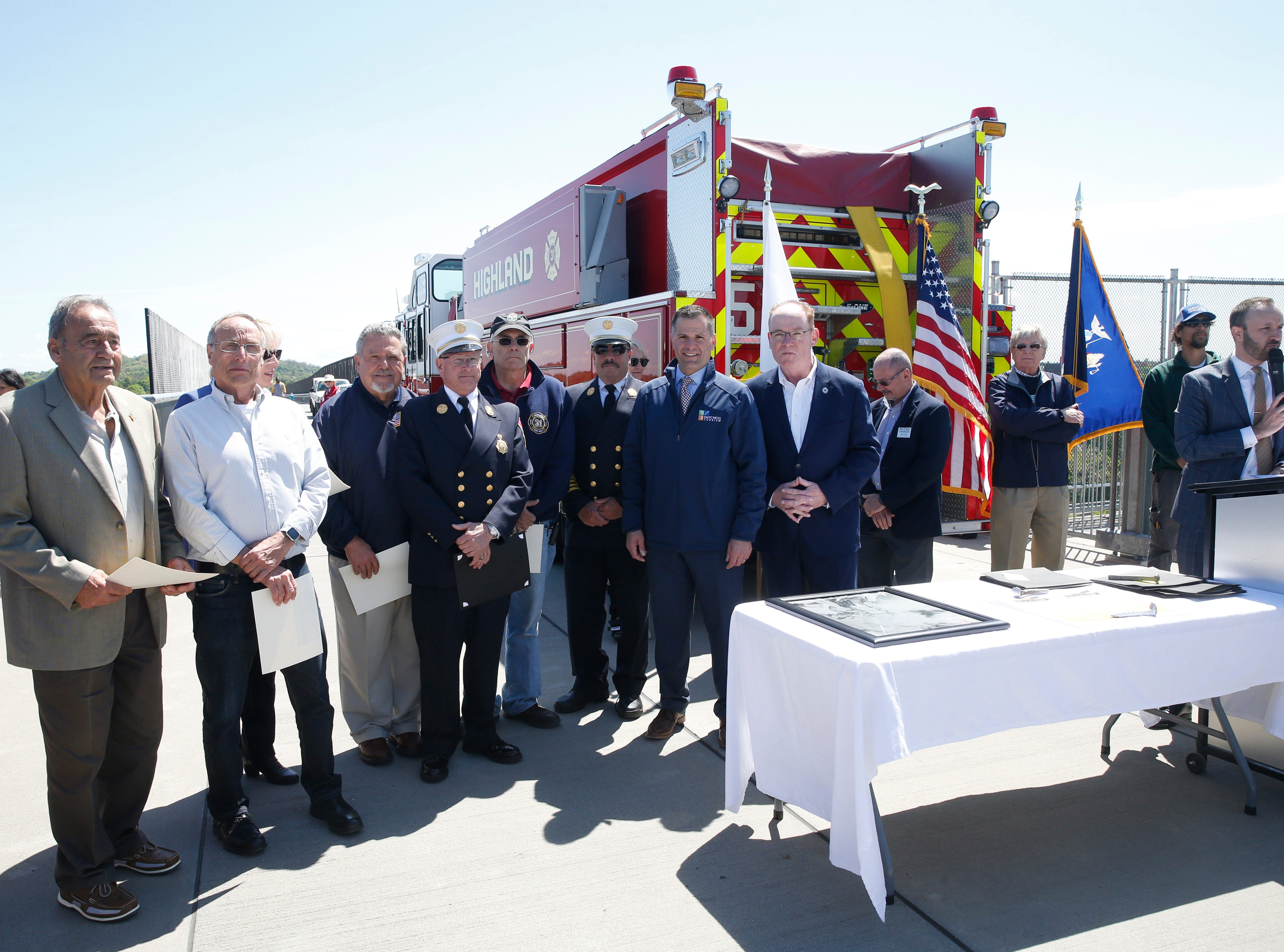 Firefighters and their representatives who were honored during Wednesday's commemoration of 45th anniversary of the fire that engulfed the railroad bridge on May 8, 2019. Many of the men in the photo fought the fire in 1974 and were given certificates to commemorate their work.