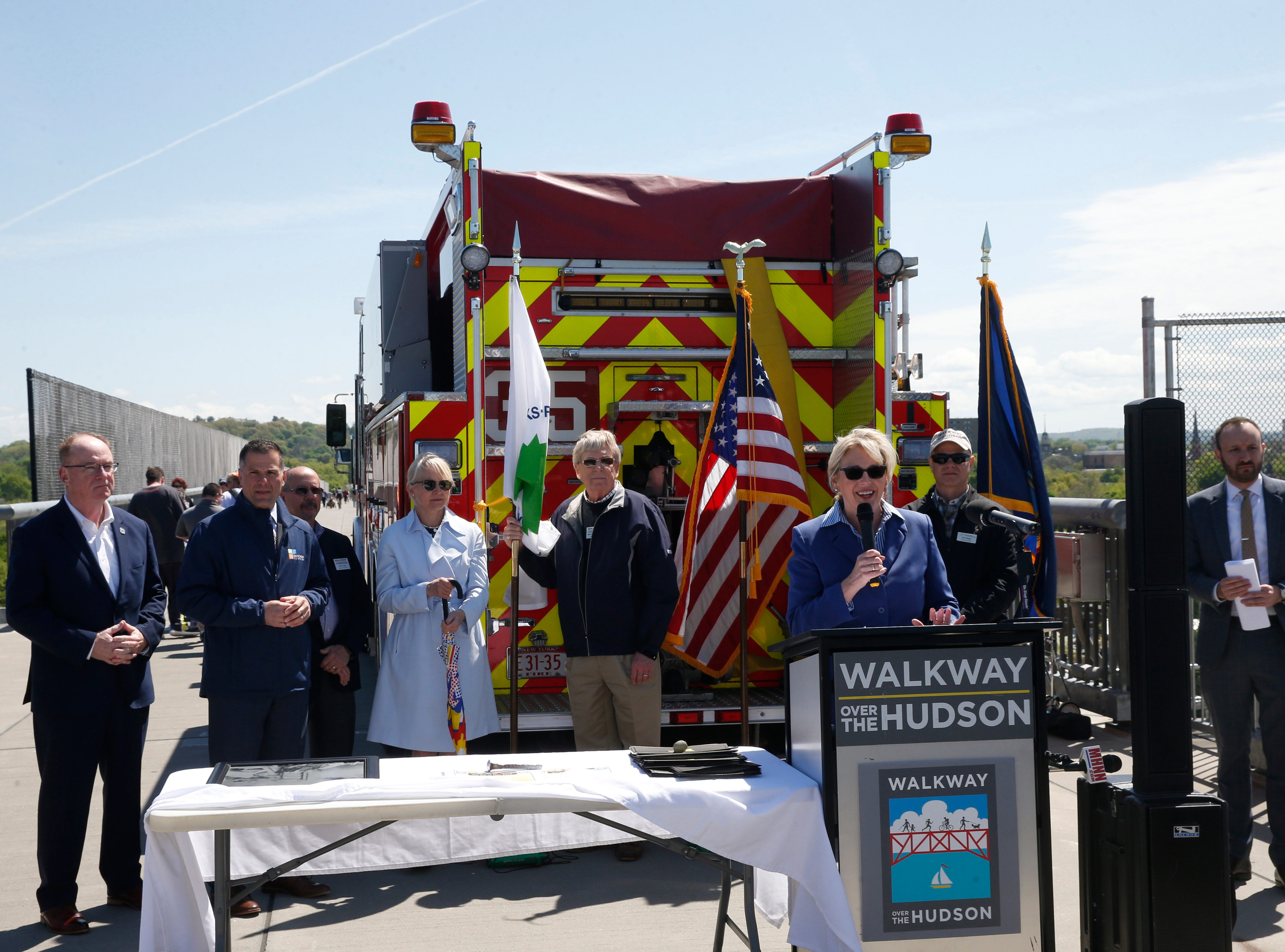Walkway Over the Hudson executive director Elizabeth Waldstein-Hart speaks during Wednesday's commemoration of 45th anniversary of the fire that engulfed the railroad bridge on May 8, 2019.