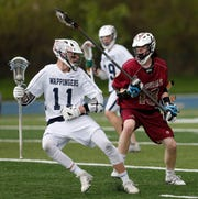 Wappingers' Matt Long is covered by Arlington's Billy Kelly during Tuesday's game at John Jay High School on May 7, 2019.