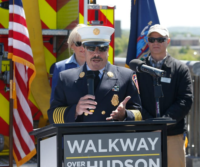 City of Poughkeepsie Fire Chief Mark Johnson speaks on May 8, 2019, during a commemoration of the 45th anniversary of the fire that engulfed the railroad bridge.