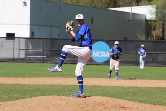 Kevin Ehrman winds up for Wilson College baseball.