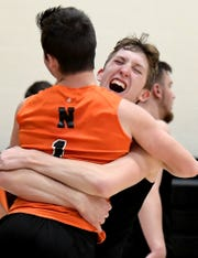 Northeastern's Alex Finch and Tristan Schraudner (1) celebrate a 3-1 victory over host Central York Tuesday, May 7, 2019. The Bobcats earned the York-Adams League regular-season title with the win. Bill Kalina photo