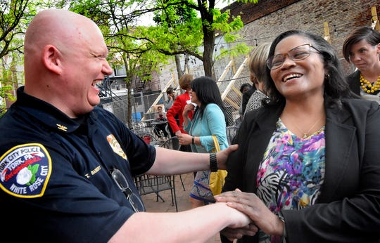 York City Police Chief Troy Bankert talks with community activist and CRC representative Ophelia Chambliss during a Confronting Racism Coalition press conference outside the Jewish Community Center's IDEAS Center in Cherry Lane Park Wednesday, May 8, 2019. During the event, members of the CRC shared its vision for creating equality in the York Community. Bill Kalina photo