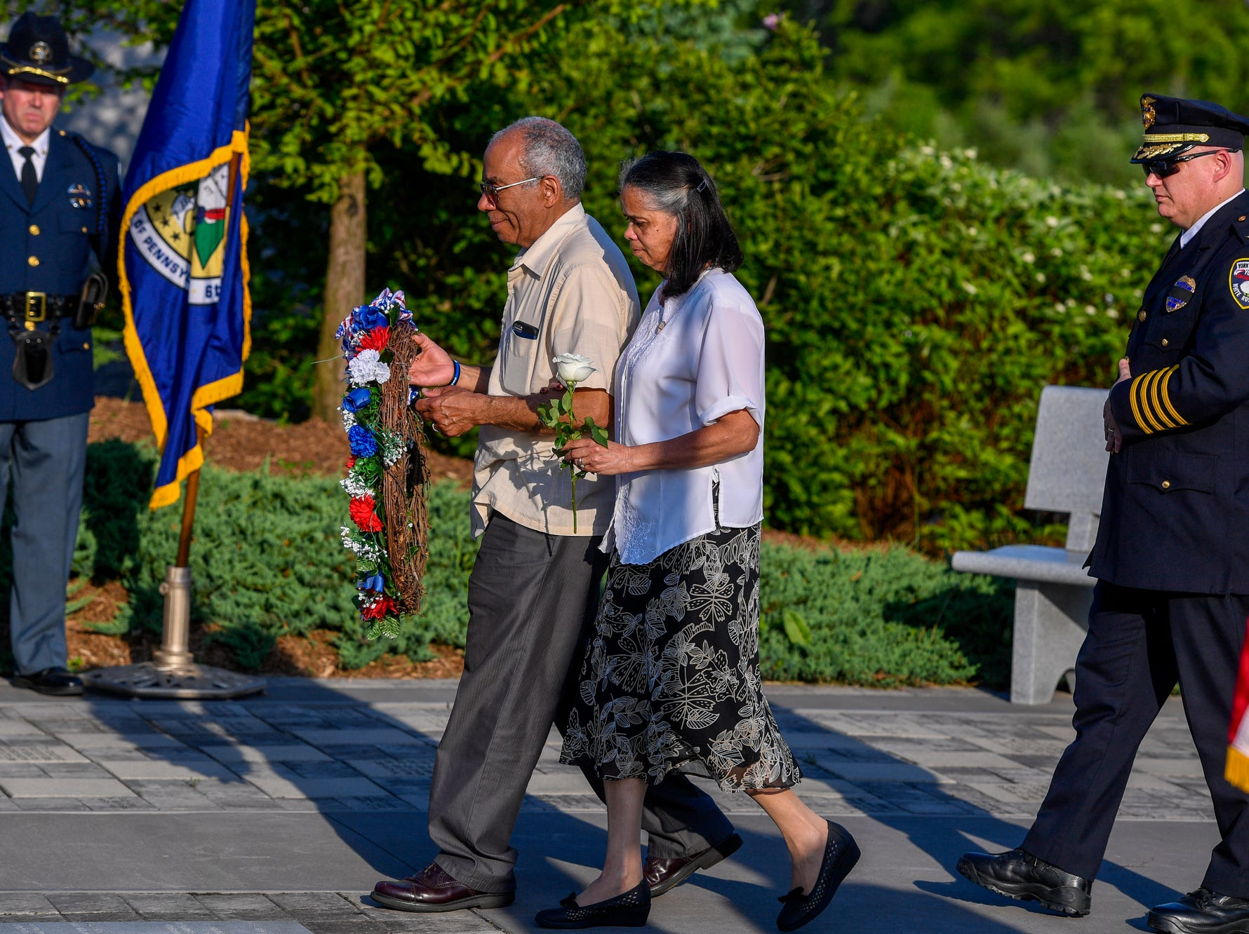 Alix and Arelis Sable place a wreath and a white rose at the Safekeepers Shrine in honor of their son, York City Police Officer Alex Sable, during theLaw Enforcement Community Remembrance event at Prospect Hill Cemetery,  Tuesday, May 7, 2019.