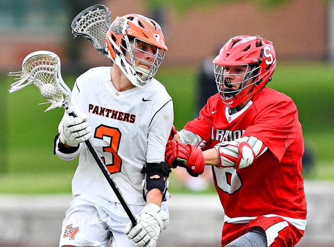 Central York's Matt Hawksworth, left, works to get around Susquehannock's Ben Wilson during boys lacrosse semifinal action at South Western High School in Hanover, Wednesday, May 8, 2019. Dawn J. Sagert photo
