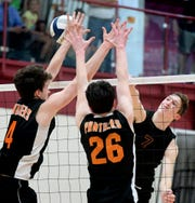 Northeastern's Alex Finch slams a shot past Central's Matthew Minkin, left, and Eric Bowman at Central York Tuesday, May 7, 2019. The Bobcats earned the York-Adams League regular-season title with a 3-1 win. Bill Kalina photo