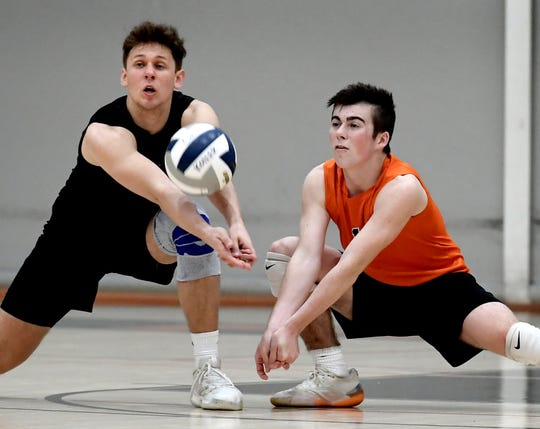 Northeastern's Nate Wilson, left, and Tristan Schraudner vie for a return during the 2019 season. Wilson recently committed to play volleyball at Ohio State.