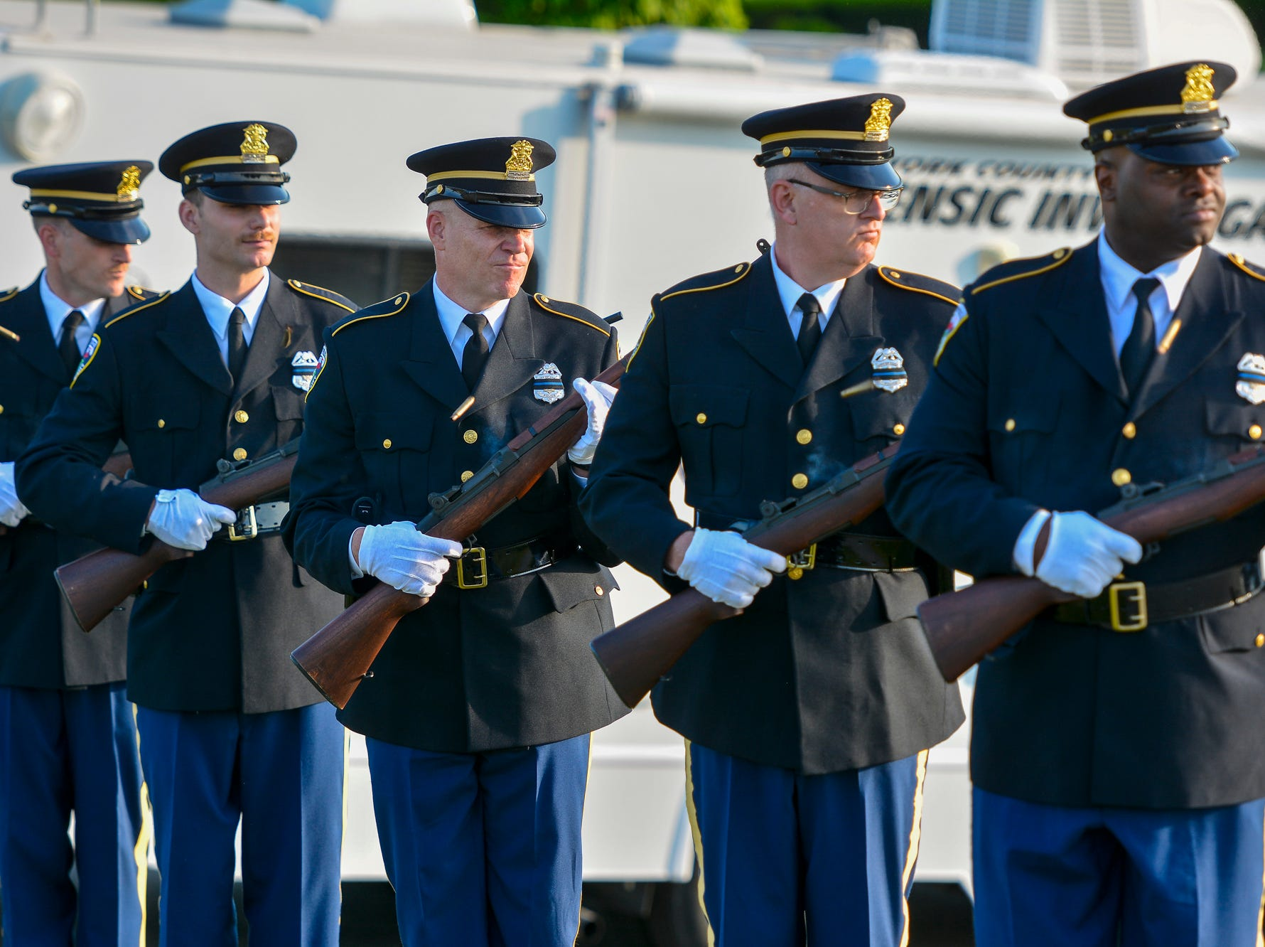 The York City Police Honor Guard fire a three-round salute during the Law Enforcement Community Remembrance event at Prospect Hill Cemetery,  Tuesday, May 7, 2019.