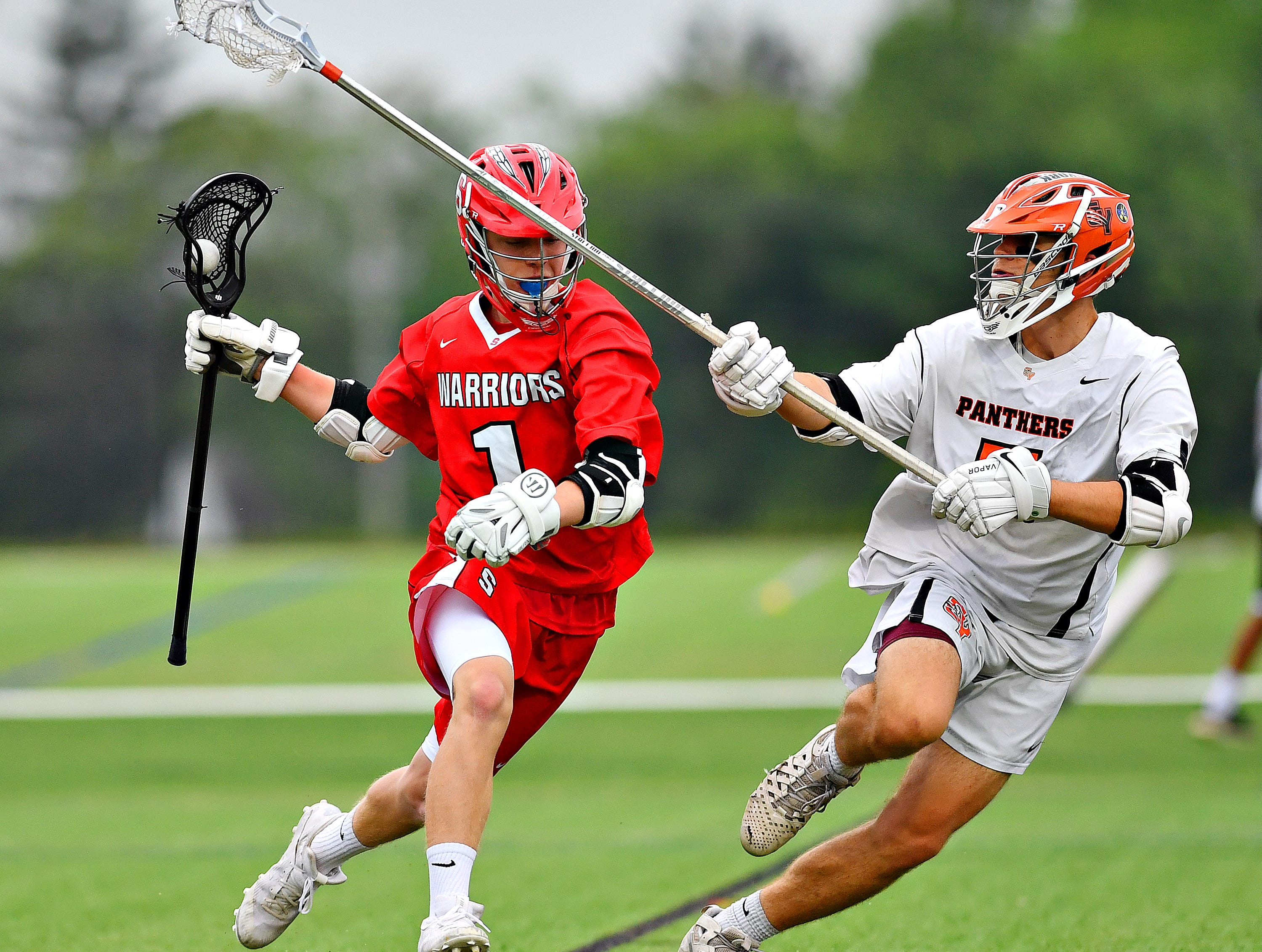 Susquehannock's Ben Tomasic, left, works to get around Central York's Robert Stockbower during boys lacrosse semifinal action at South Western High School in Hanover, Wednesday, May 8, 2019. Central York would win the game 10-4. Dawn J. Sagert photo