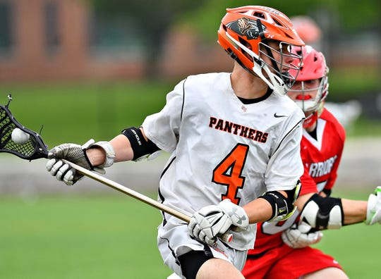 Central York's Coley Bagwell, left, moves to get past Susquehannock's Luke Ohmann during boys lacrosse semifinal action at South Western High School in Hanover, Wednesday, May 8, 2019. Dawn J. Sagert photo