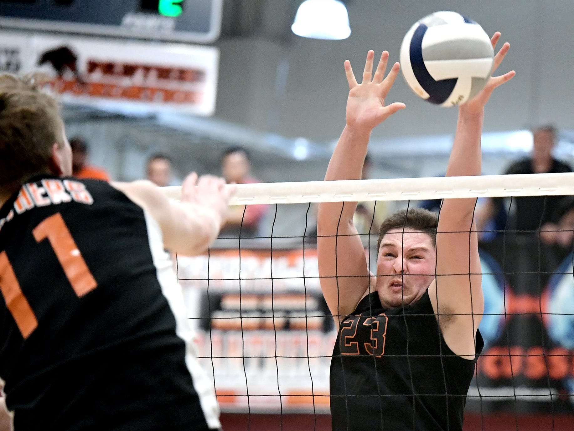 Northeastern's Kyle Williams tries to stop a shot by Central's Braden Richard, left, during action at Central York Tuesday, May 7, 2019. The Bobcats earned the York-Adams League regular-season title with a 3-1 win. Bill Kalina photo