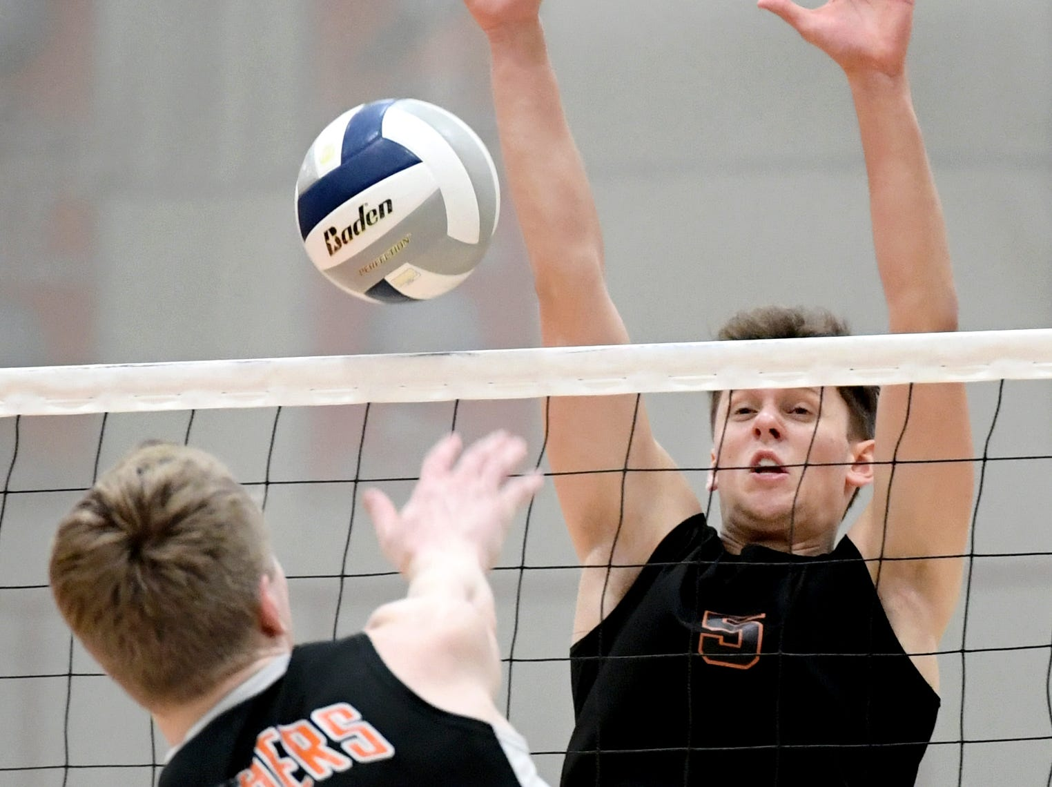 Northeastern's Nate Wilson tries to block a shot by Central's Braden Richard, left, during action at Central York Tuesday, May 7, 2019. The Bobcats earned the York-Adams League regular-season title with a 3-1 win. Bill Kalina photo