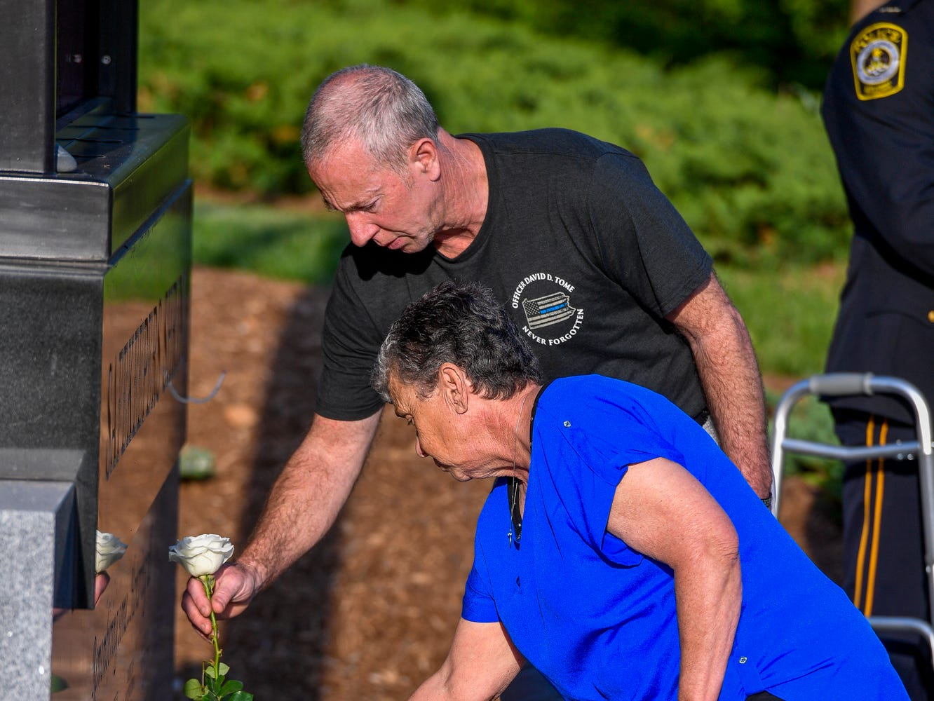 David and Karen Reever place a white rose at the Safekeepers Shrine in honor of their son Officer David Tome during the Law Enforcement Community Remembrance event at Prospect Hill Cemetery,  Tuesday, May 7, 2019.