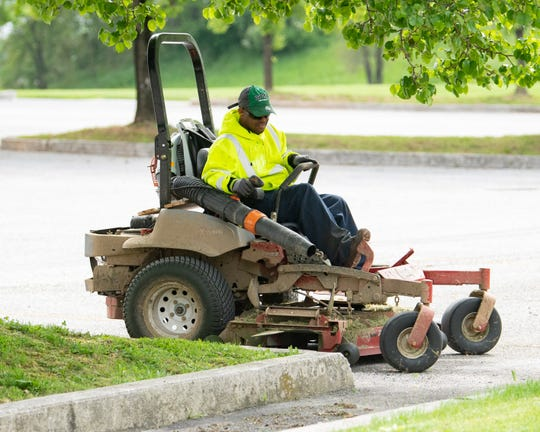 A worker takes great care in clearing out excess grass, May 8, 2019.