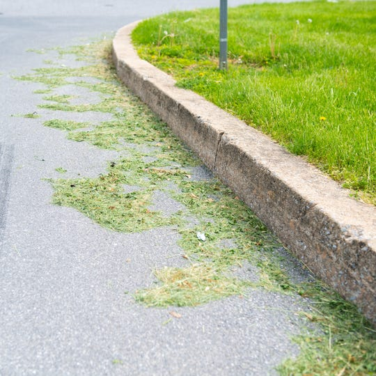 Freshly cut grass sits on the side of Colony Road in West Manchester Township, May 8, 2019.