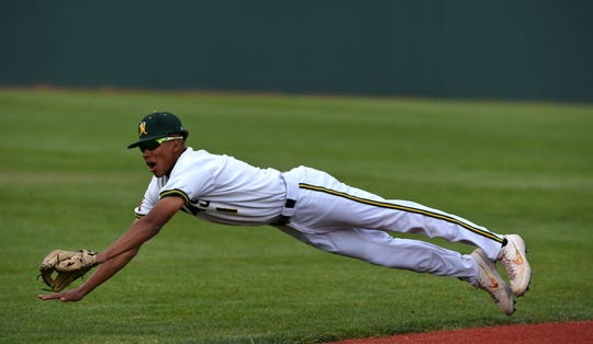 Manogue's Josh Rolling dives for a line drive during a Northern Region game last season.