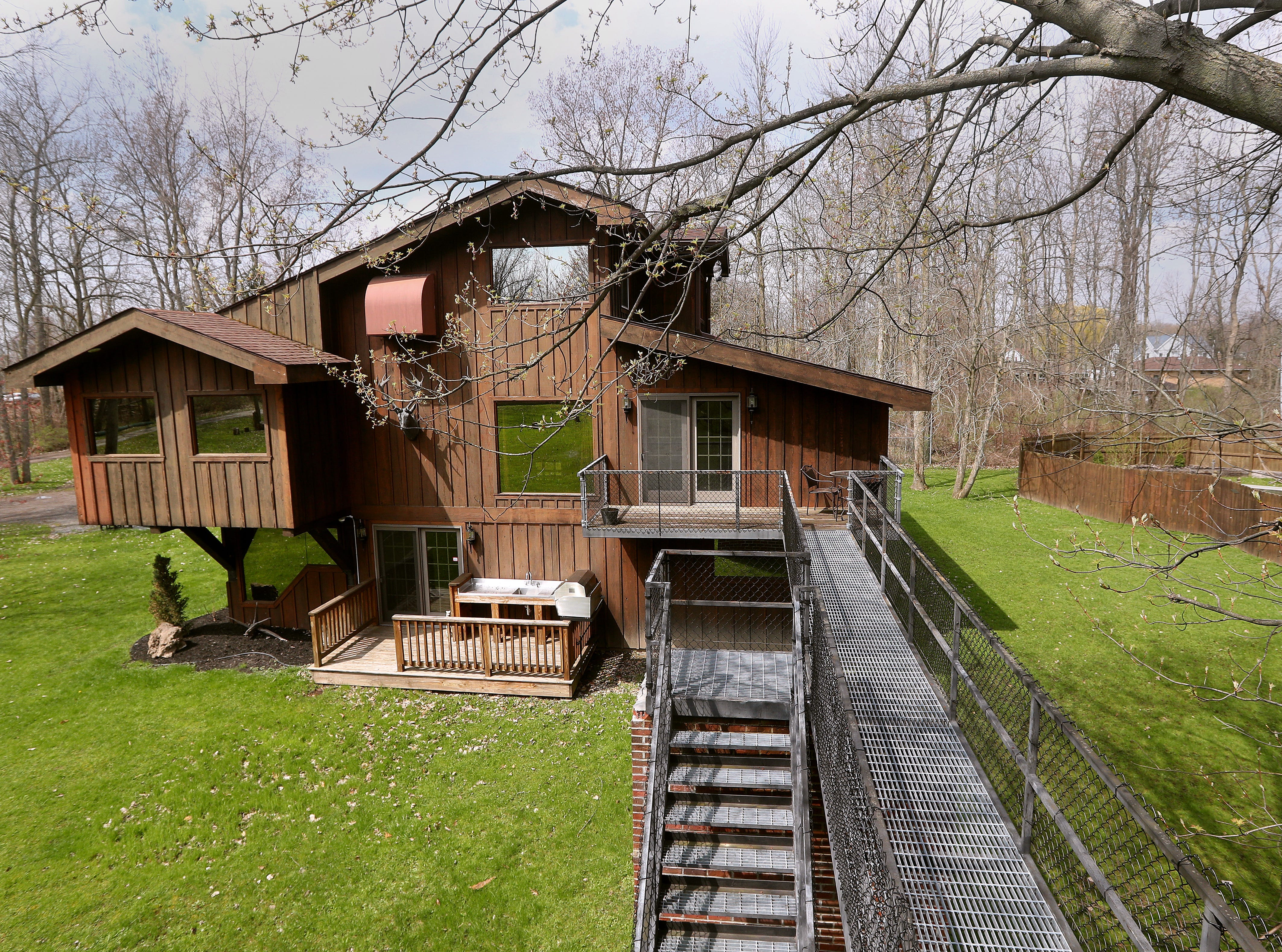 The elevated steel walkway that connects the treehouse to the main house.