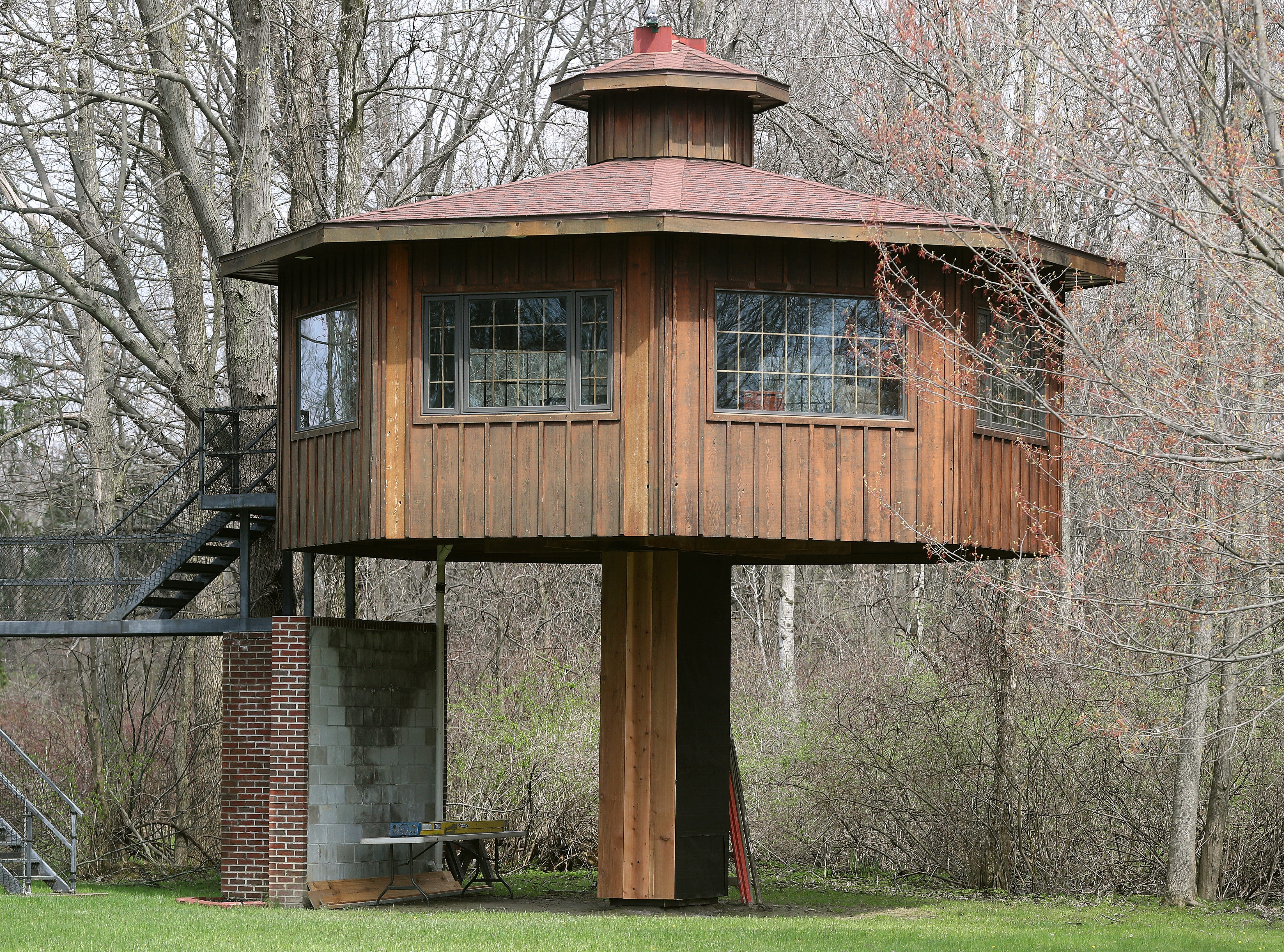 An elevated gazebo-style building sometimes referred to as a treehouse.
