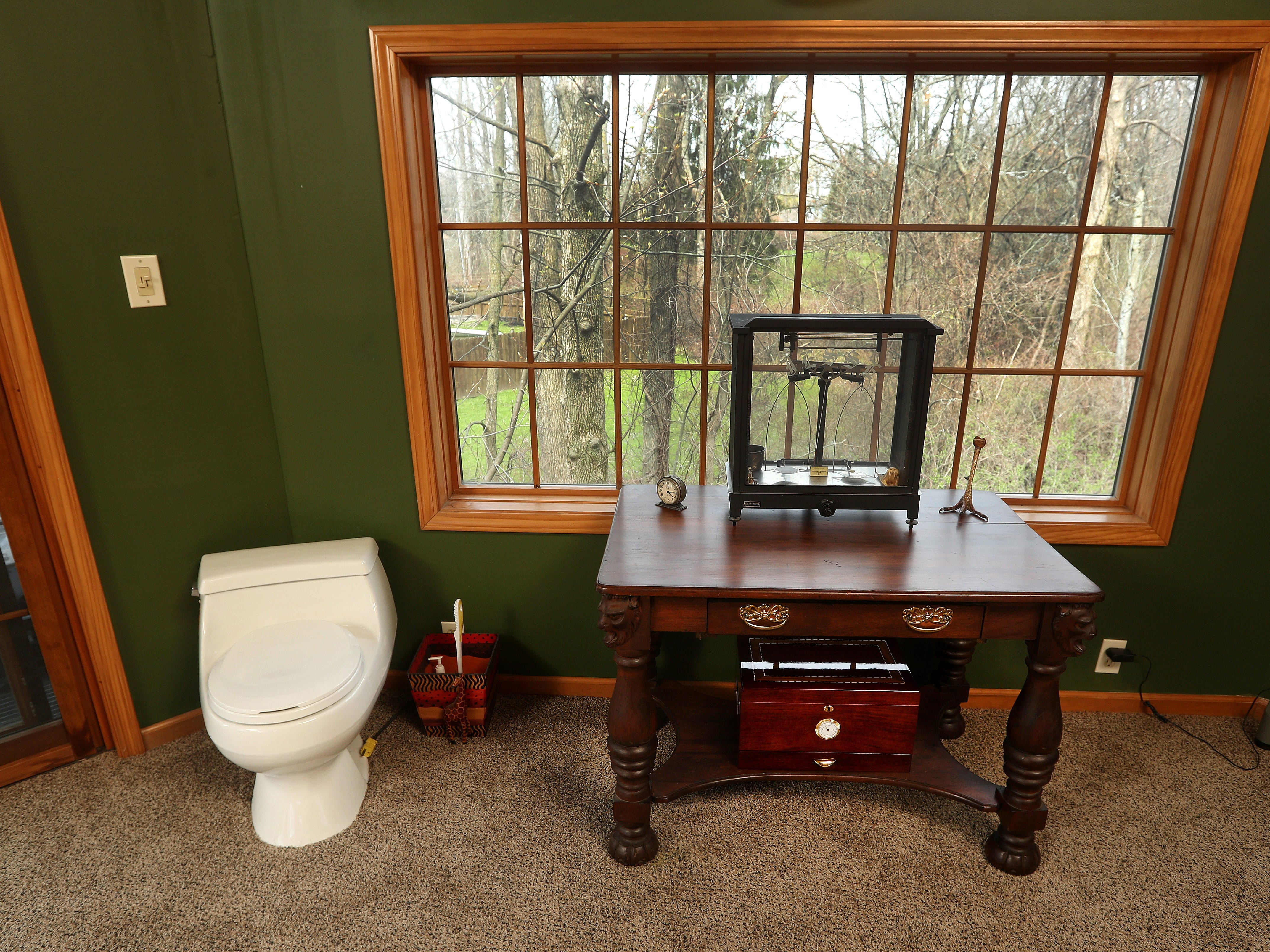 A commode in the open area of the treehouse.