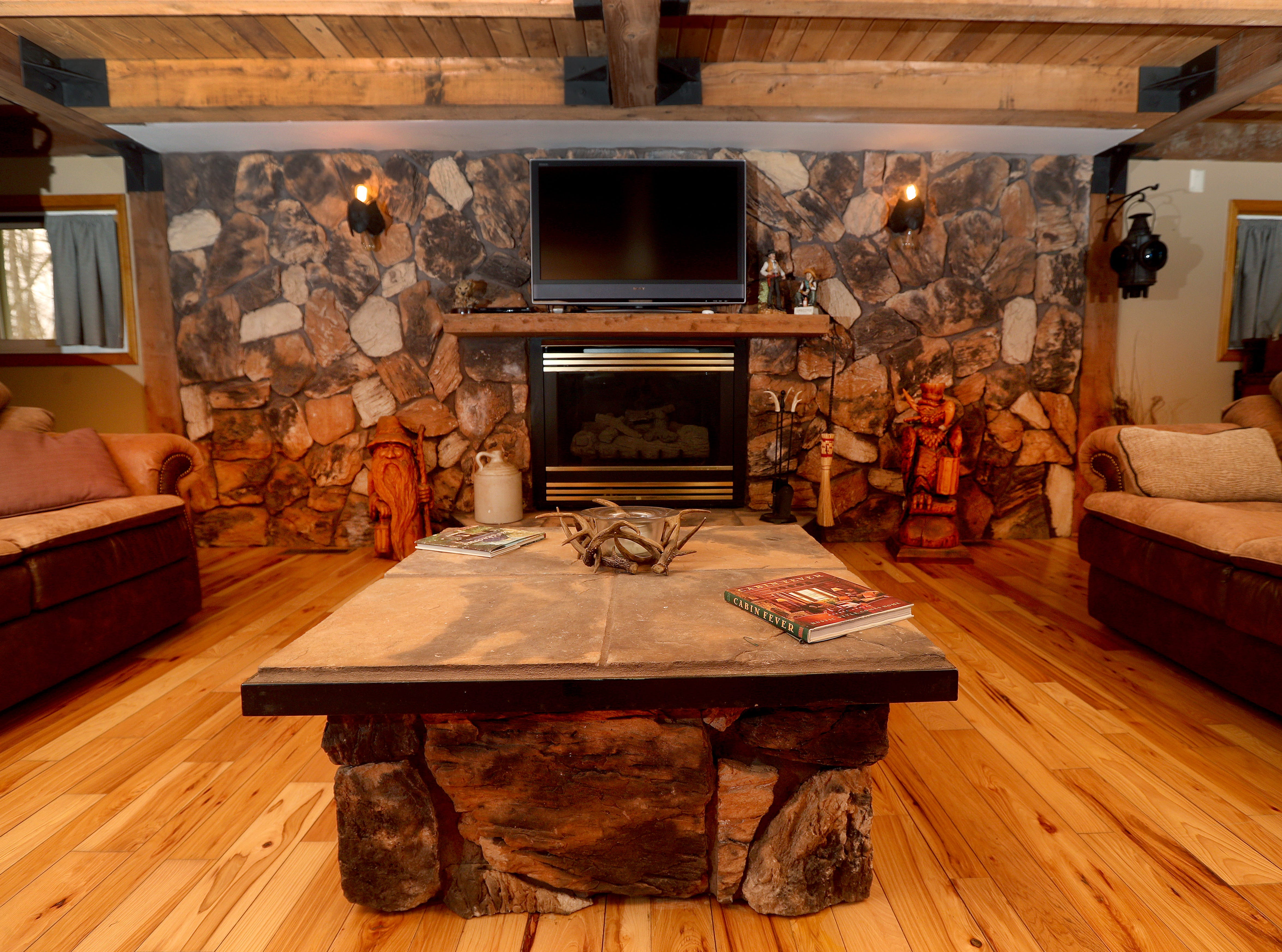 The living room area of the main house includes a fireplace.