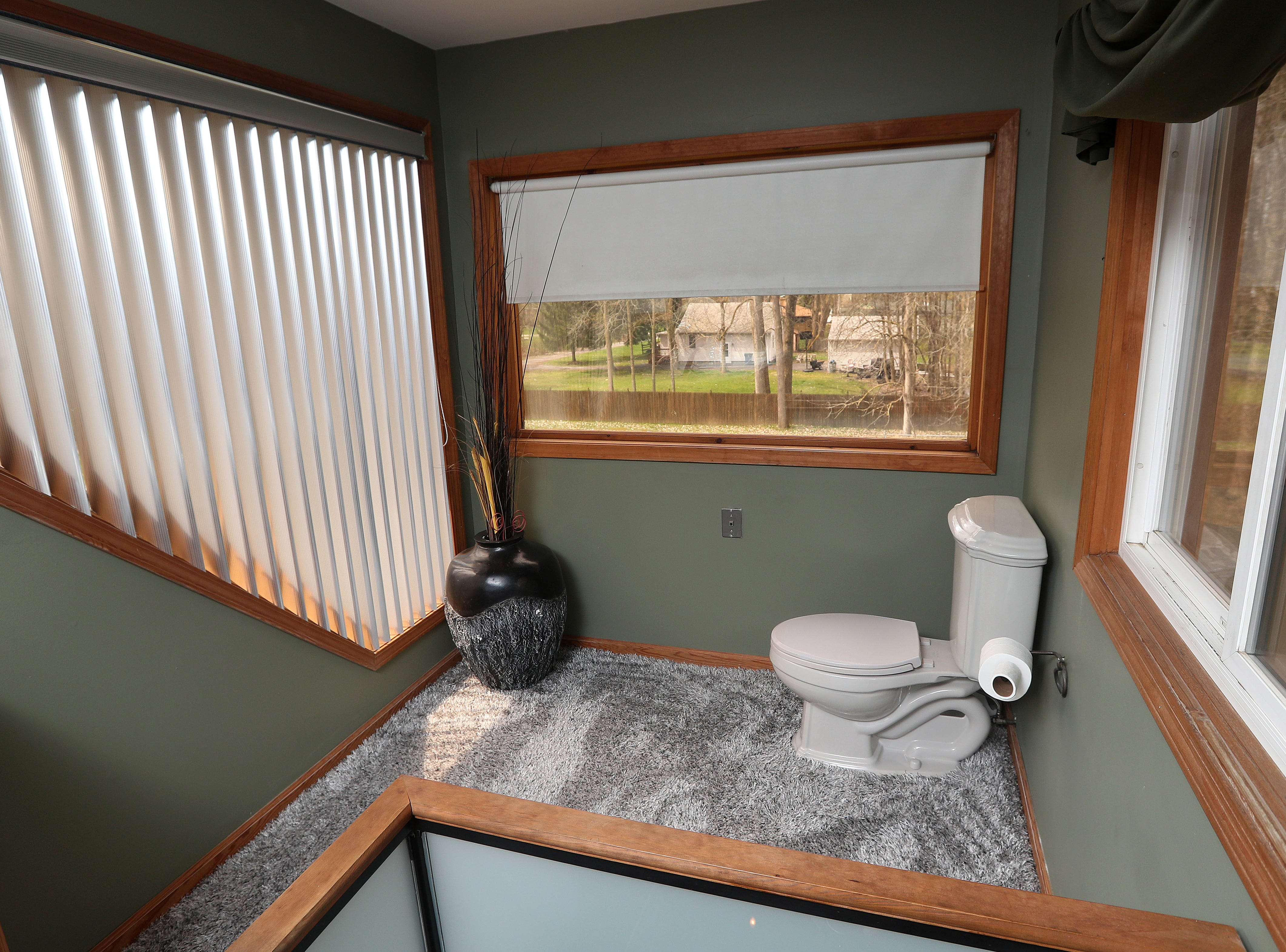 The bathroom overlooking part of the property.
