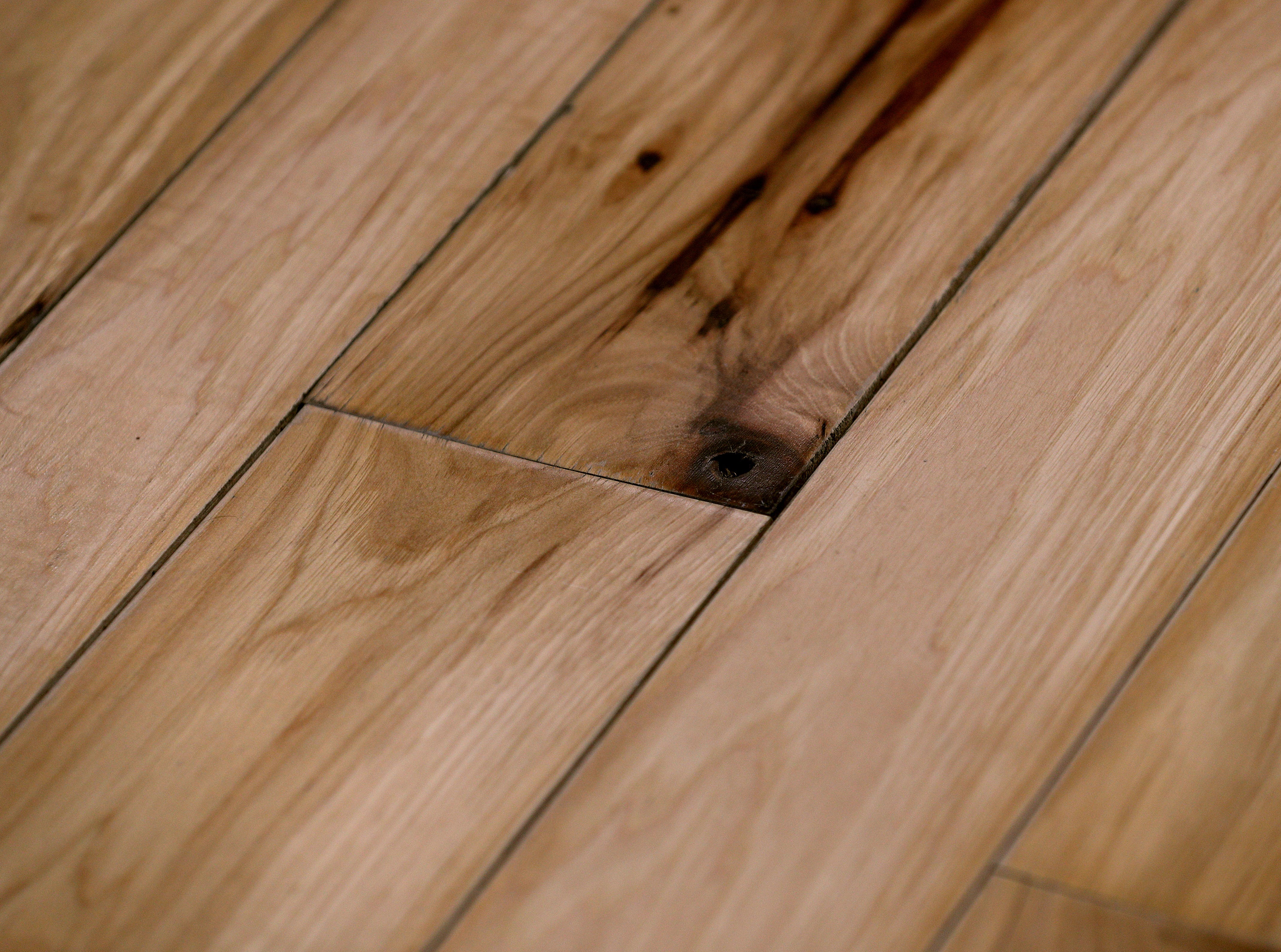 There are wood floors throughout the house.