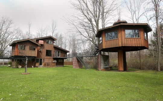 This custom built home in Amherst, New York, includes this second building which is connected to the main house by an elevated walkway.