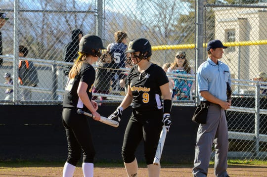 Enterprise sophomore Rylie Gilbreath (right) approaches the plate in a 2019 game.