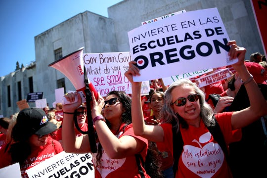 Tareli Monataño, a two way immersion teacher in Woodburn, holds the megaphone while rallying with other teachers during a rally for education funding at the Oregon State Capitol in Salem on May 8, 2019.