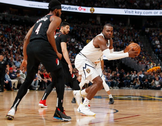 Denver Nuggets forward Paul Millsap, right, looks to shoot the ball as Portland Trail Blazers forward Maurice Harkless defends in the first half of Game 5 of an NBA basketball second-round playoff series, Tuesday, May 7, 2019, in Denver.