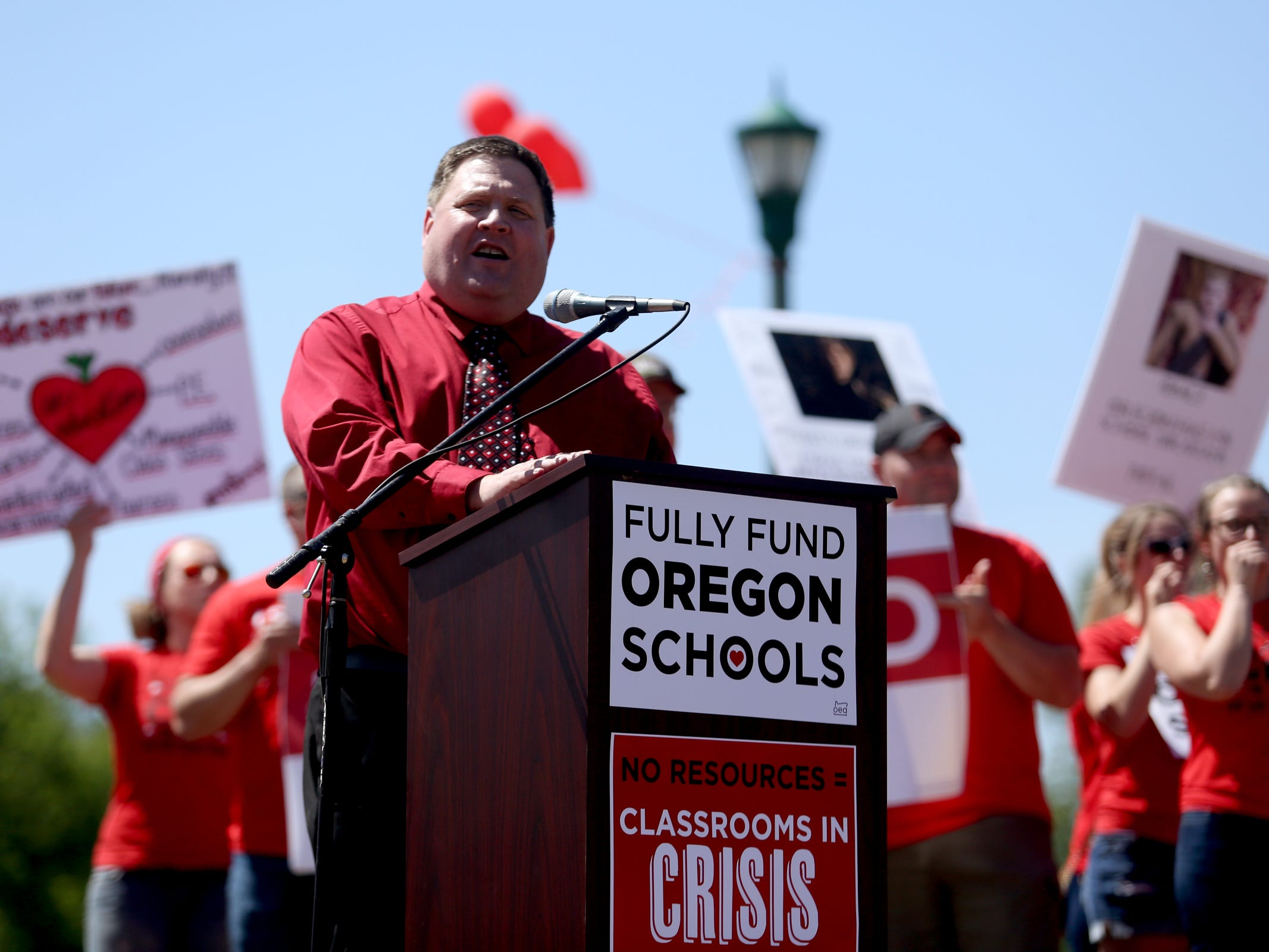 John Larson, the Oregon Education Association president, speaks as thousands of teachers and education activists rally for a day of action starting at Riverfront Park in Salem on May 8, 2019. Schools across Oregon closed early or were closed for the day as teachers walked out to demand more school funding to address large class sizes, low graduation rates and other concerns.