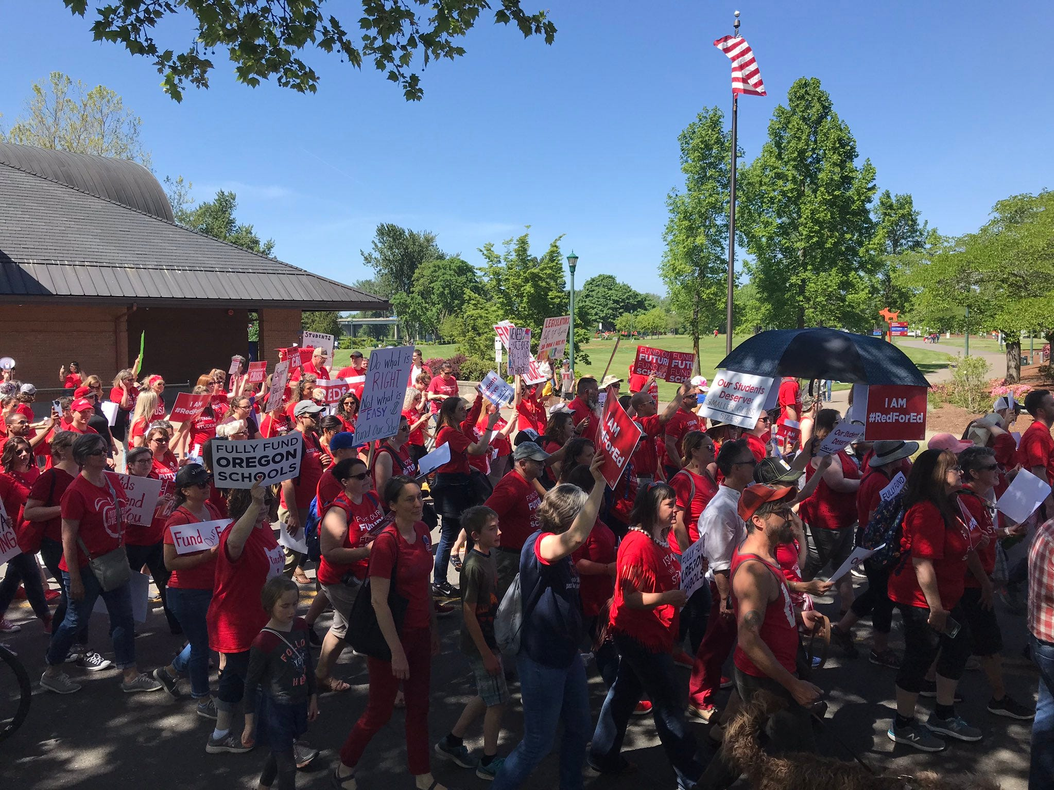 People marched from Riverfront Park to the Capitol for an education funding rally Wednesday, April 8, 2019.